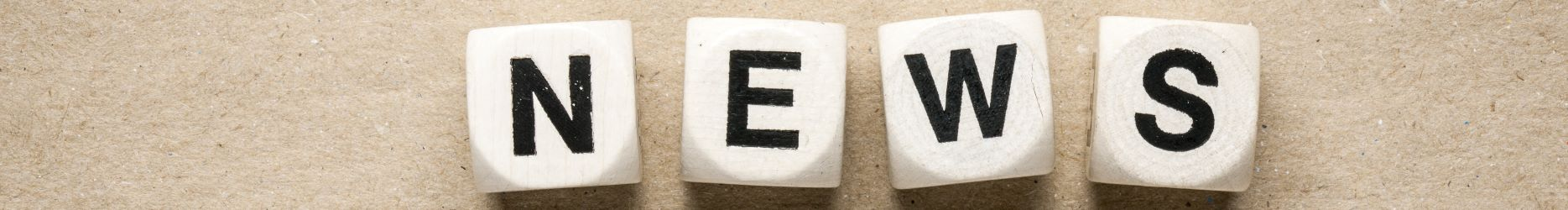 Image of dice spelling the word, 'News'.
